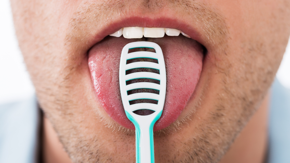 what is the benefit of brushing your tongue